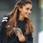 EXCLUSIVE: Ariana Grande leaves a recording studio holding a CD
